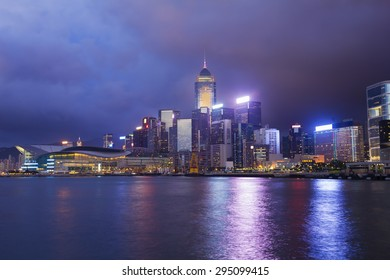 Cityscape in Hong Kong with illuminated buildings at twilight