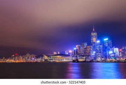 Cityscape in Hong Kong with illuminated buildings at twilight. Victoria harbour at night in Hong Kong