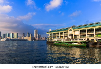 cityscape in Hong Kong with illuminated buildings. Victoria harbour at sunset in Hong Kong