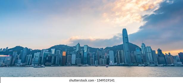 Cityscape of Hong Kong island during suset, viewed from Tsim Sha Tsui district, Hong Kong