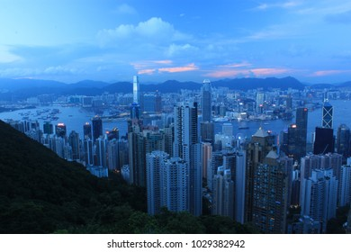 The cityscape of Hong Kong as viewed from Victoria Peak during a summer evening