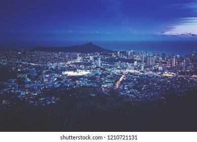 Cityscape of Honolulu city light and Diamond Head with blue hour from Tantalus lookout in the Puu Ualaka'a State Park, Honolulu, Oahu, Hawaii USA