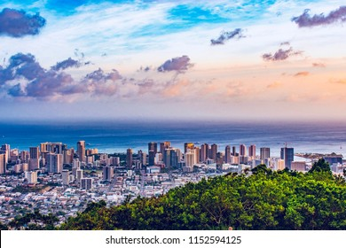 Cityscape of Honolulu city and  Waikiki beach with blue sky , ocean and light reflection from sunset sky to buildings from Ualaka'a lookout on Tantalus mountain  in Honolulu, Oahu, Hawaii USA