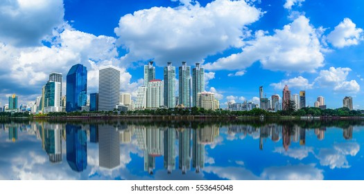 Cityscape image of Benchakitti Park at blue sky background in Bangkok, Thailand.