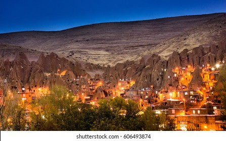 Cityscape image of Kandovan village during twilight blue hour a tourist destination of troglodyte dwellings in East Azarbaijan, Tabriz, Iran/similar to dwellings in the Turkish region of Cappadocia