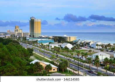 Cityscape image of Panama City Beach, Florida, along Front Beach Road at dusk
