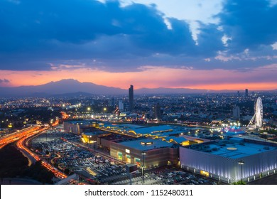 Cityscape image of Puebla, Mexico during twilight blue hour. Panorama at night angelopolis