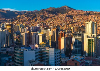 Cityscape of La Paz with its modern urban skyline and skyscrapers at sunset, Andes Mountains, Bolivia.