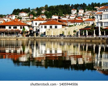 Cityscape and landscape in Orhid old city in Macedonia in the afternoon, with skyscape reflection on watersurface, Orhid is the largest city onLake Ohrid and part of UNESCO Cultural and Natural sites
