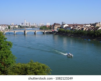 Cityscape landscapes of swiss european Basel city and Middle bridge over Rhine River with motorboat in Switzerland with clear blue sky in 2017 warm sunny summer day on July.