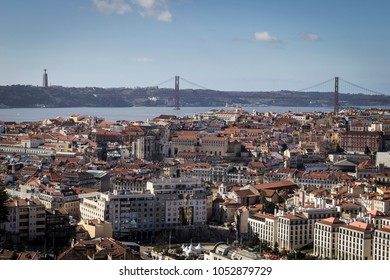 Cityscape of Lisabon, Portugal with the bridge of the 25th April over the river Tejo and the Cristo Rei statue in the background