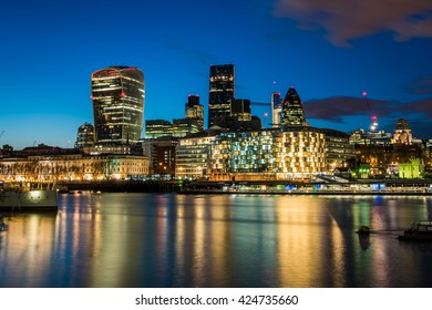 Cityscape of London business area at night, United Kingdom