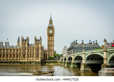 Cityscape of London with the famous Big Ben by the Westminster bridge, with the sightseeing boat tour passing by. Big Ben is the nickname for the Great Bell of the clock tower, aka Elizabeth Tower.
