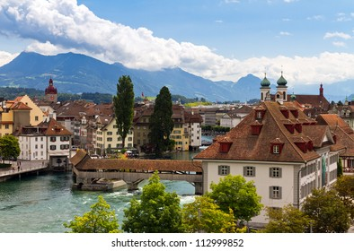 Cityscape of Lucerne looking over the river towards the old city with the footbridges