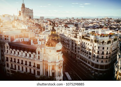 Cityscape of Madrid at sunset, with Gran Vaa street.