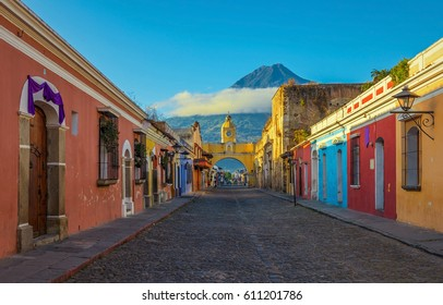 Cityscape in the main street of Antigua city with the Agua volcano in the background, Guatemala.