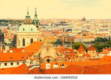 Cityscape of Mala Strana (Lesser Town) in Prague, Czech Republic. Beautiful baroque St. Nicolas Church. Part of UNESCO World Heritage Site.