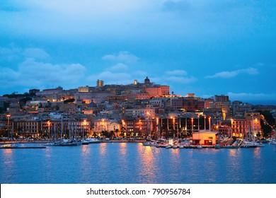 Cityscape with marina in the Mediterranian sea in the evening in Cagliari, Sardinia, Italy