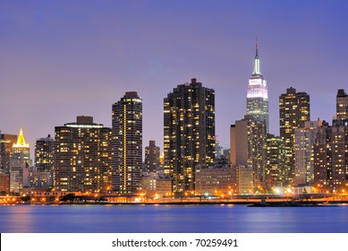 Cityscape of Midtown Manhattan across the Hudson River at night.