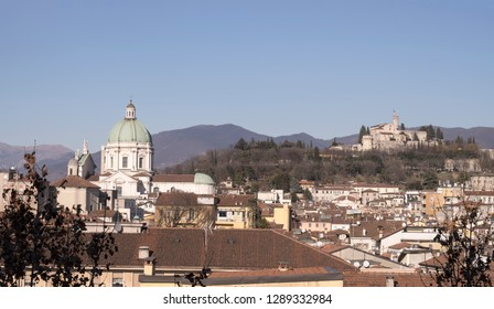 cityscape with minster dome in town center and Castle over town roofs, shot in bright winter light  at Brescia, Italy