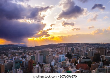 Cityscape of miyagi, city aerial skyscraper view of office building and downtown of sendia with sunset rays of light shining down pass clouds background. Japan, Asia