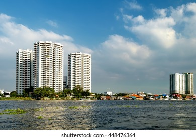 Cityscape with modern building near the river in the afternoon at Chao Phraya River in Bangkok, Thailand
