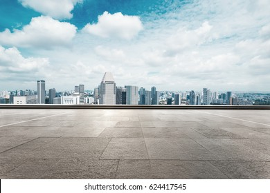 cityscape of modern city from empty brick floor in cloud sky