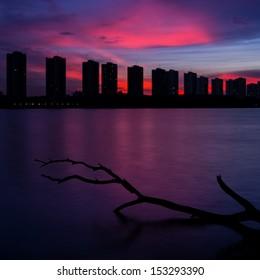 CItyscape modern residential building near the Bangkok sunset sky beautiful.