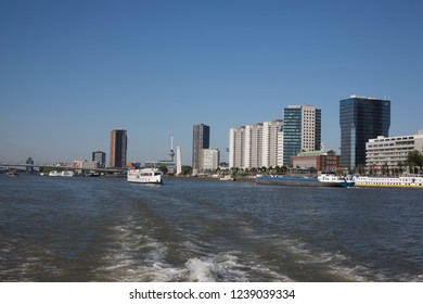 Cityscape of modern Rotterdam with river