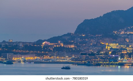 Cityscape of Monte Carlo day to night transition timelapse, Monaco after summer sunset. Evening mist. Yachts on harbor. Top view from Cap Martin
