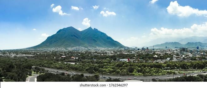 Cityscape of Monterrey Nuevo Leon Mexico sunny day blue sky Cerro de la silla
