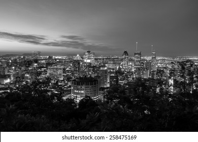 Cityscape of Montreal, view to the mountain of Mont-Royal in black and white at night