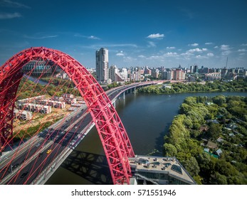 Cityscape of Moscow with the cable-stayed bridge, Russia. Moscow skyline in summer. Beautiful panorama of the Moscow city with a river. Scenic view of modern urban architecture of Moscow from above.