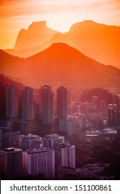 Cityscape with mountain range in the background at dusk, Rio De Janeiro, Brazil