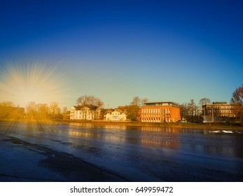 Cityscape near the river in winter season with gold light and navy blue sky background, Karlstad, Sweden