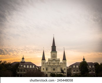 Cityscape of New Orleans and the St. Louis Cathedral with an orange sunset
