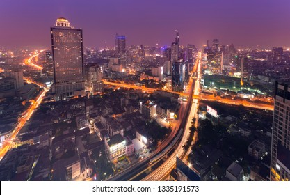 Cityscape at night in Bangkok with electric train(BTS).
