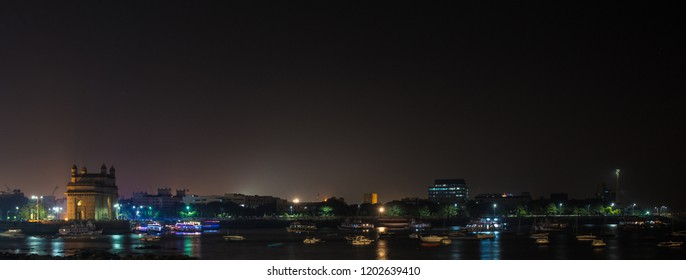 Cityscape night shot of Mumbai with the Gateway of India on the left