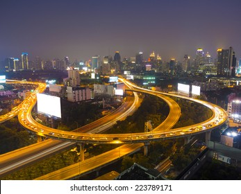 cityscape in the night showing many building and street light on a Express Way of Bangkok, Thailand