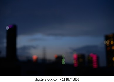 Cityscape in the night time of capital city with many building and lighting for background and texture