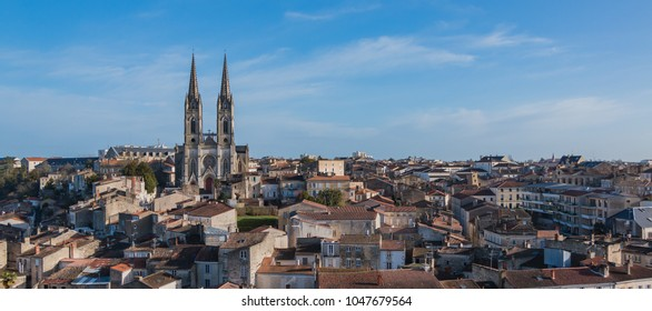 A cityscape of Niort with the Saint Andre Church on the left.