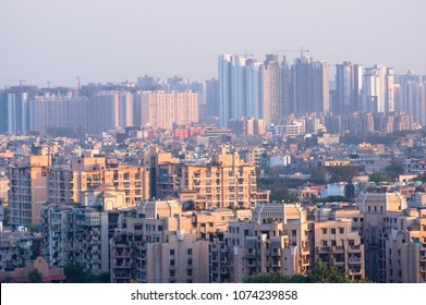 Cityscape in Noida, gurgaon, jaipur, delhi, lucknow, mumbai, bangalore, hyderabad showing small houses sky scrapers and other infrastructure options