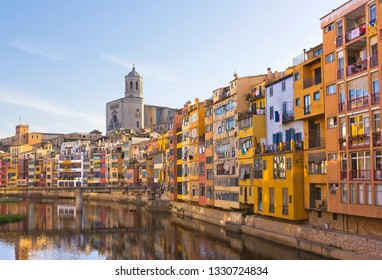 Cityscape with old houses on the riverbank in Girona, Catalonia, Spain