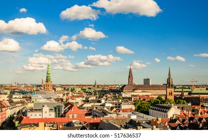 Cityscape of the old part of the city with bridge (Church of Our Saviour, Sankt Nikolaj Kirke) from the observation deck at the Round tower (Rundetaarn) in Copenhagen, Denmark