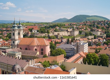 Cityscape of the old town of Eger, Hungary, church of saint anthony of padua and fortress of Eger, taken from the tower of the observatory