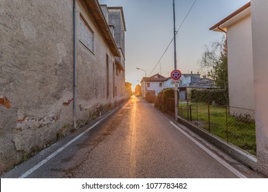 cityscape. one narrow street in small italian city at sunset.