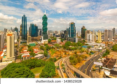 The cityscape of Panama city with its most famous skyscrapers in the financial district at sunrise with the morning traffic on the highway, Panama, Central America.