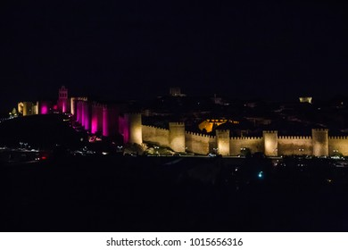 cityscape. panoramic view of the historic city Avila, famous medieval walls surround the city, UNESCO World Heritage Site at night in Spain