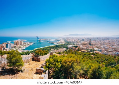 Cityscape Panoramic View Of Malaga, Spain. View From Old Medieval Fortress.