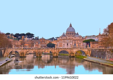 cityscape and panoramic view of old bridge with blue sky water reflections and dome of St. Peters cathedral church with old buildings and architecture in Rome, Italy